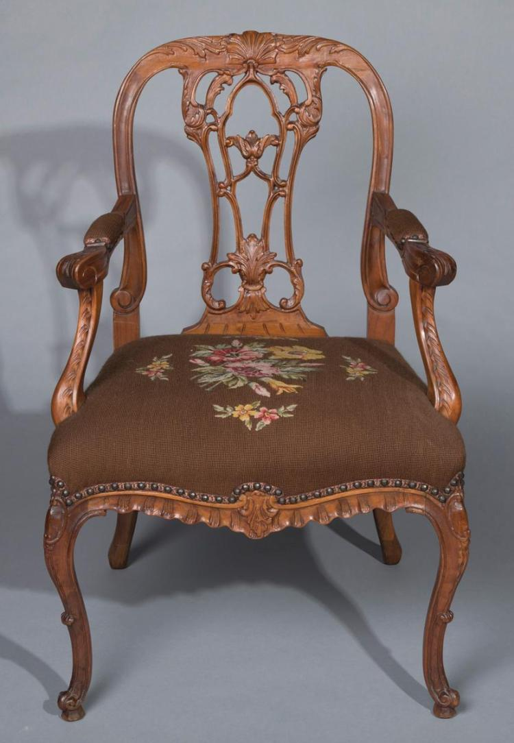 Hand carved Chippendale armchair with needlepoint upholstery