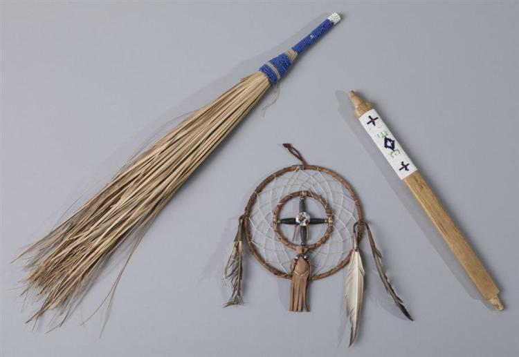 Three Native American items including a sweetgrass fan with beaded handle, a beaded pipe stem, and a dream catcher.