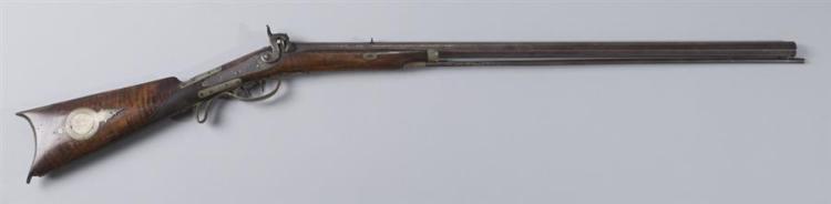 Antique hex barrel cap and ball rifle.