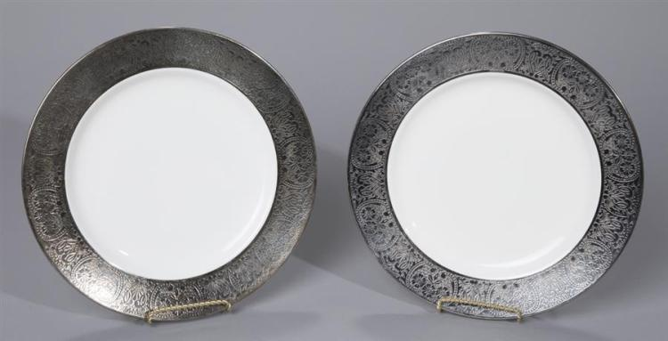 Twelve Minton Dinner Plates with Silver Overlay Rims Property from the estate of Carl G. and Alma C. Stifel.