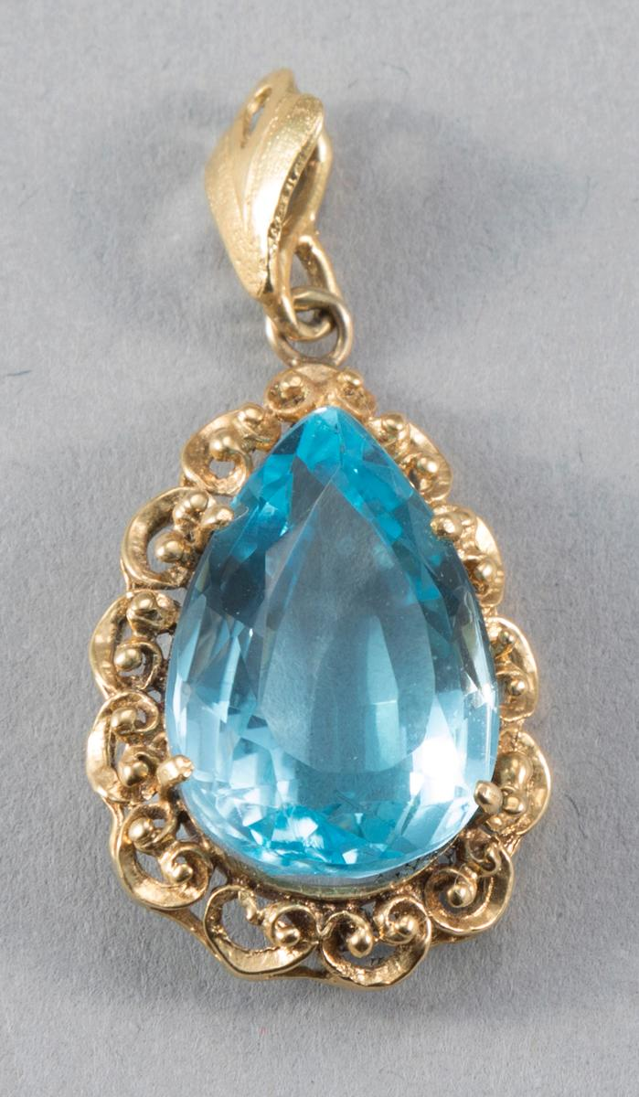 Pear Shaped Blue Topaz Pendant Set in 18K Yellow Gold