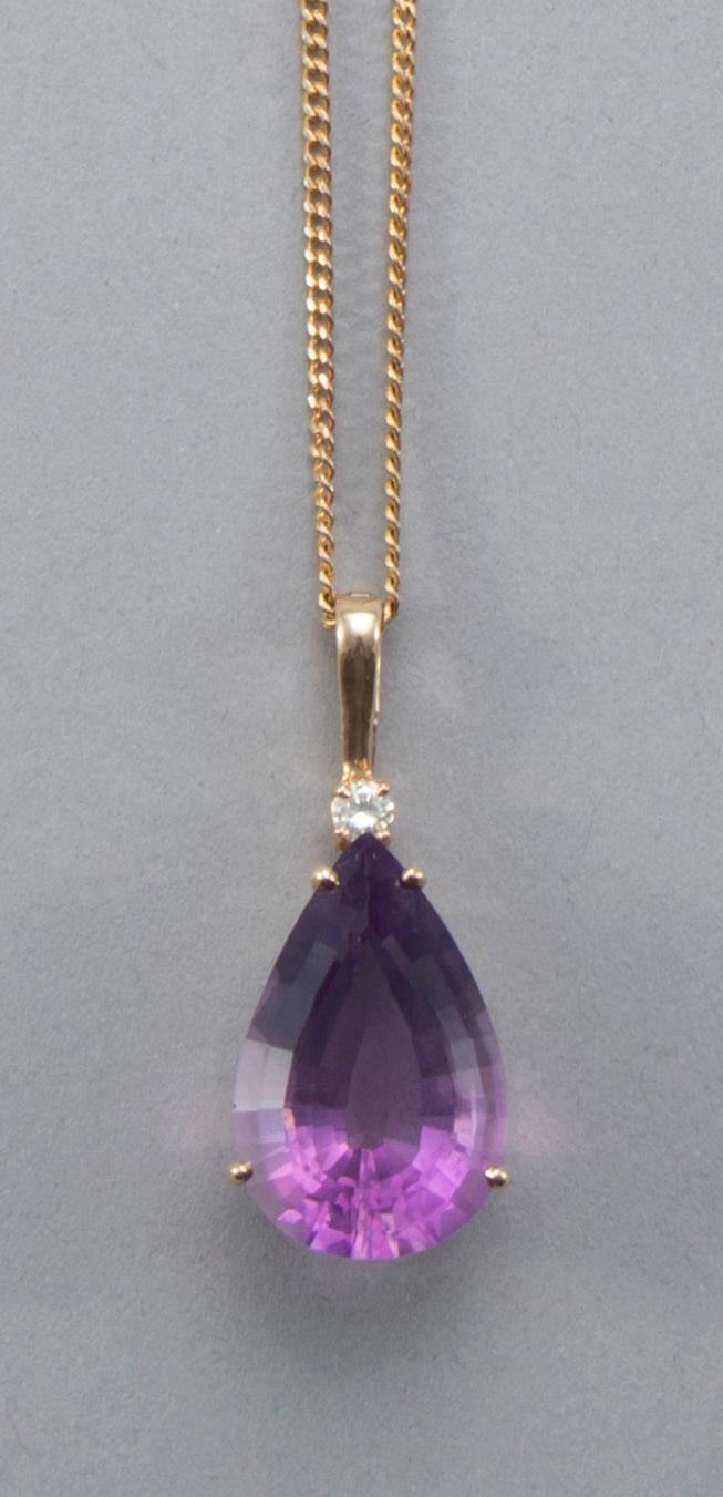 Pear shaped amethyst pendant in basket style setting with hinged bail. the amethyst measuring 26 x 18 mm, surmounted by a round bril...