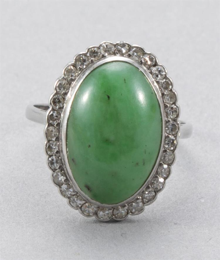 Vintage ladies jade ring, surrounded by diamonds in a 14k yellow gold setting.