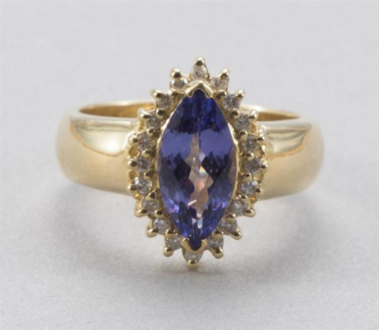 Purple stone surrounded by 20 small diamonds in 18 k yellow gold setting
