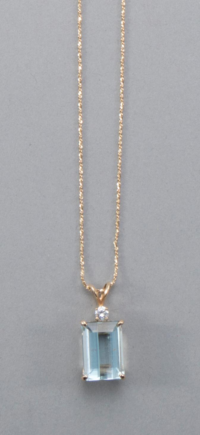 Emerald cut blue topaz pendant set in 14k yellow gold surmounted by a diamond 1/5 carat