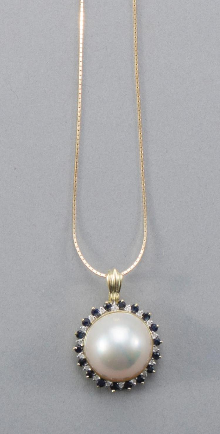 Mabe pearl, sapphire and diamond pendant in 14k yellow gold setting