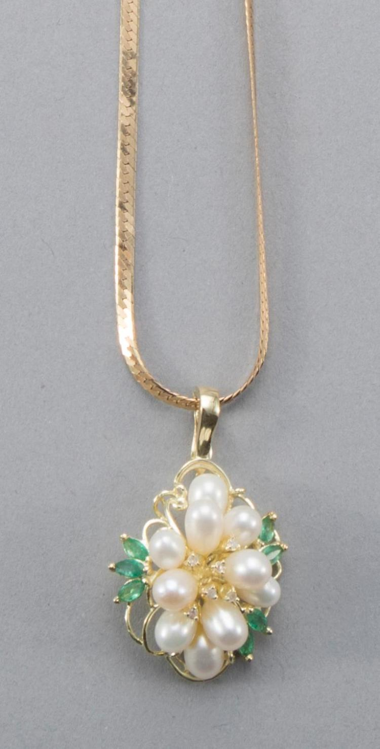 Pearl and emerald pendant in 14k yellow gold setting with hinged bail