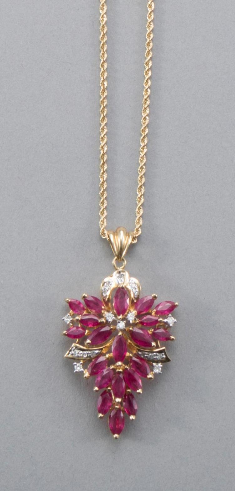 Ruby and diamond pendant set in 14k yellow gold