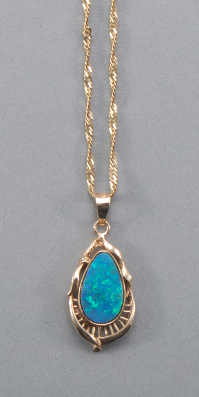 Boulder opal pendant in hand crafted 14k yellow gold setting