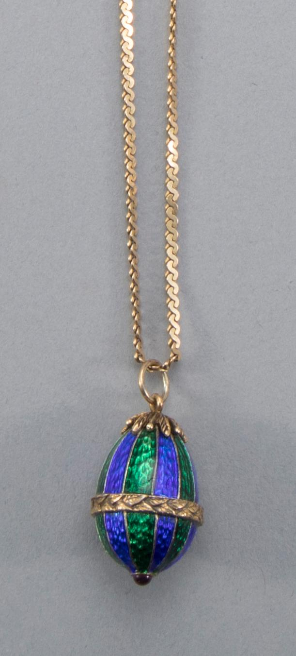 After Faberge 14k yellow gold trimmed enamel egg pendant.
