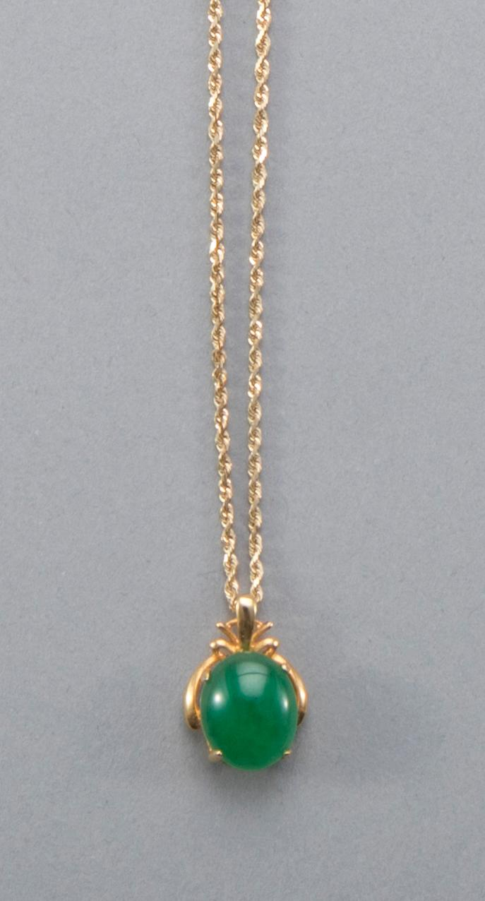 Jade pendant in 14k yellow gold setting.
