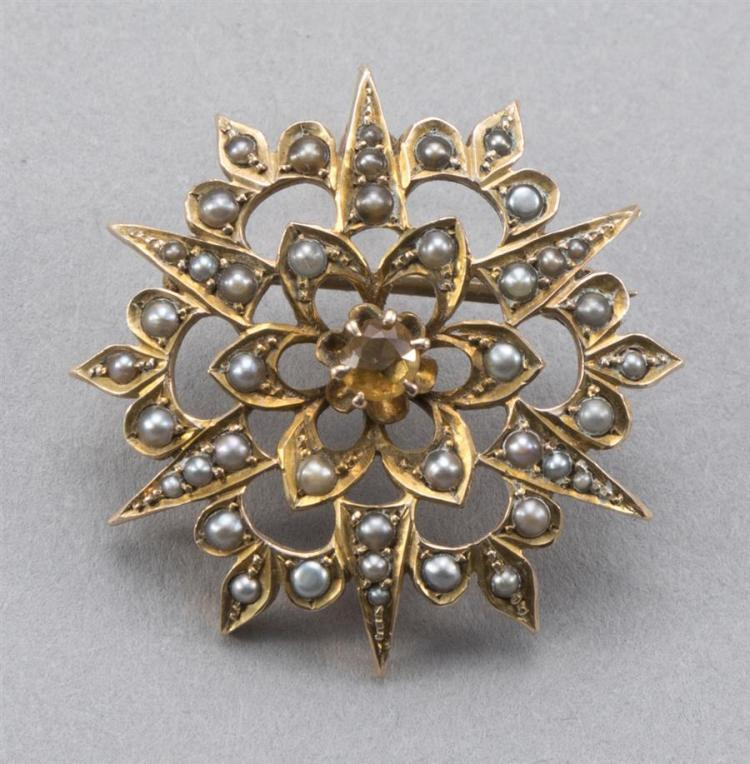 Vintage gold sunburst pin with seed pearls.