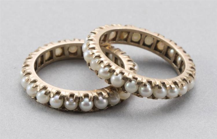 Two matching 14k yellow gold pearl eternity rings