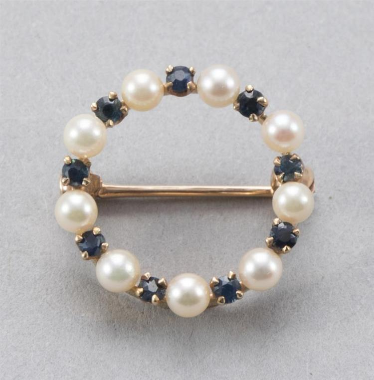14k yellow gold circular brooch set with cultured pearls and sapphires