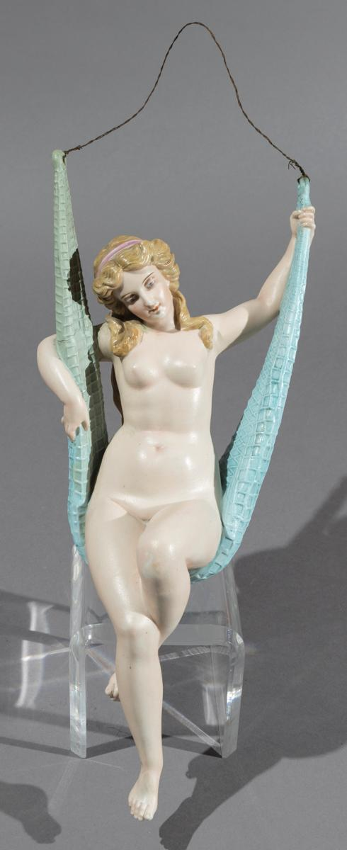 Continental Bisque Porcelain Nude Figure on a Swing