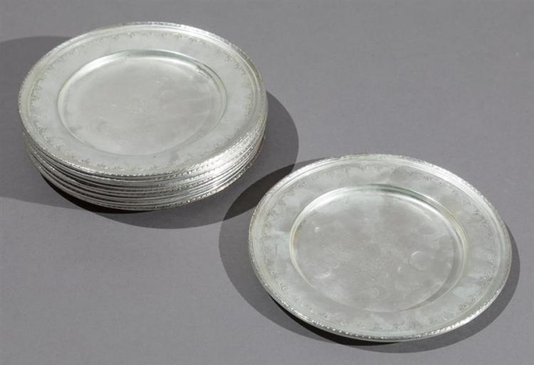 Twelve Wallace Sterling Silver Bread/Butter Plates Property from the estate of Carl G. and Alma C. Stifel.