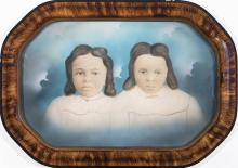 Two framed portraits of young African American girls, early 20th century
