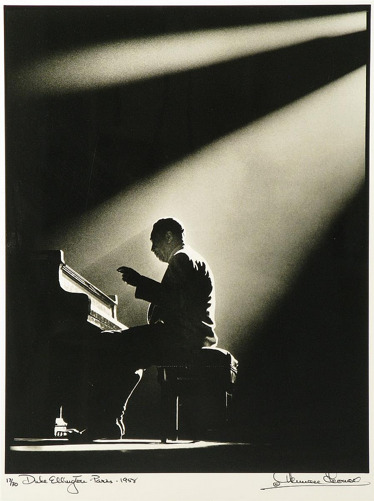 Herman Leonard, American (1923-2010), Duke Ellington, Olympic Theater, Paris, 1960, silver gelatin print, 16 1/8 x 12 1/2 inches