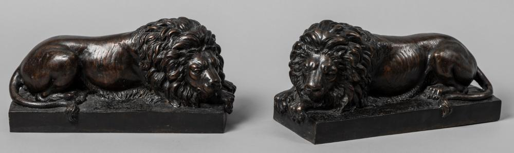 Pair of Bronze Lions In A Recumbent Manner