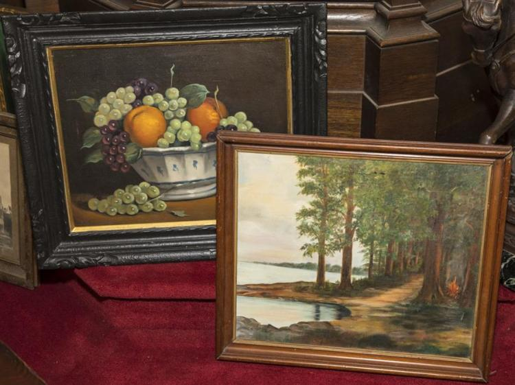 Two framed oil paintings, both signed by artists, one depicting a bowl of fruit and the other a landscape scene with a lake