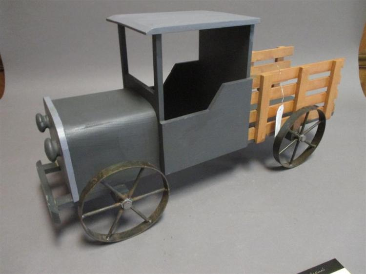 Wooden toy truck with metal wheels