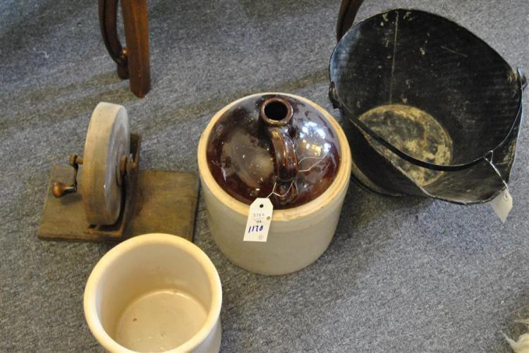 Four items including a sharpening stone, stoneware jug, crock, and coal pail