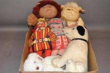 Six pieces of stuffed dolls and animals; two Cabbage Patch kids, dog, teddy bear, printed fabric