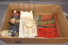 Metal dollhouse bed, four-piece dressing set, three cloth and nut dolls seated on rockers and wooden barn with fence