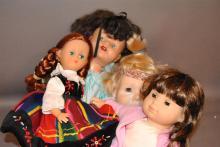 Four dolls including 15