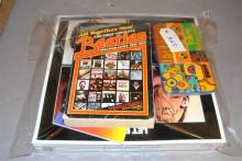Collection of items relating to BEATLES including original Yellow Submarine wallet, The First Complete Discography 1961-1975, metal ...