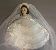 Porcelain head doll in wedding dress