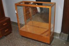 Modern design blonde Waddell wood display case with sliding doors