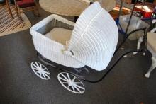 White wicker baby stroller.