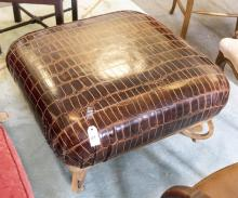 Ottoman upholstered in alligator style leather with an iron base