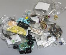 Large collection of assorted costume jewelry including earrings, necklaces and bracelets