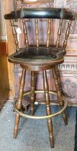 Bar stool featuring brass nailheads and foot rest
