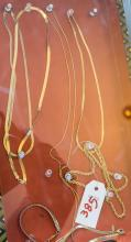 Collection of assorted costume jewelry including five necklaces and two bracelets