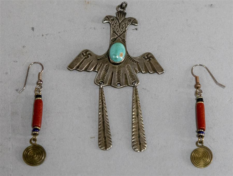 Three pieces Navajo jewelry, pair of earrings and double eagle design with turqouise centerpiece pendant