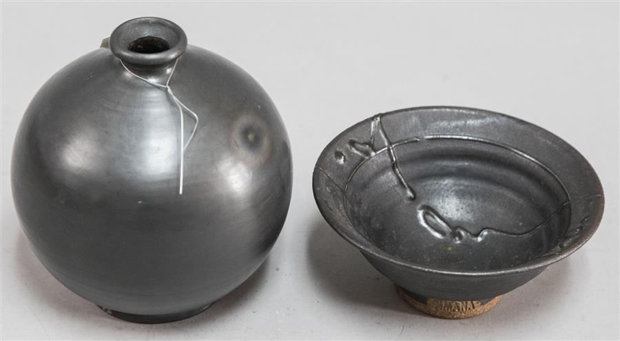 Two black pottery items
