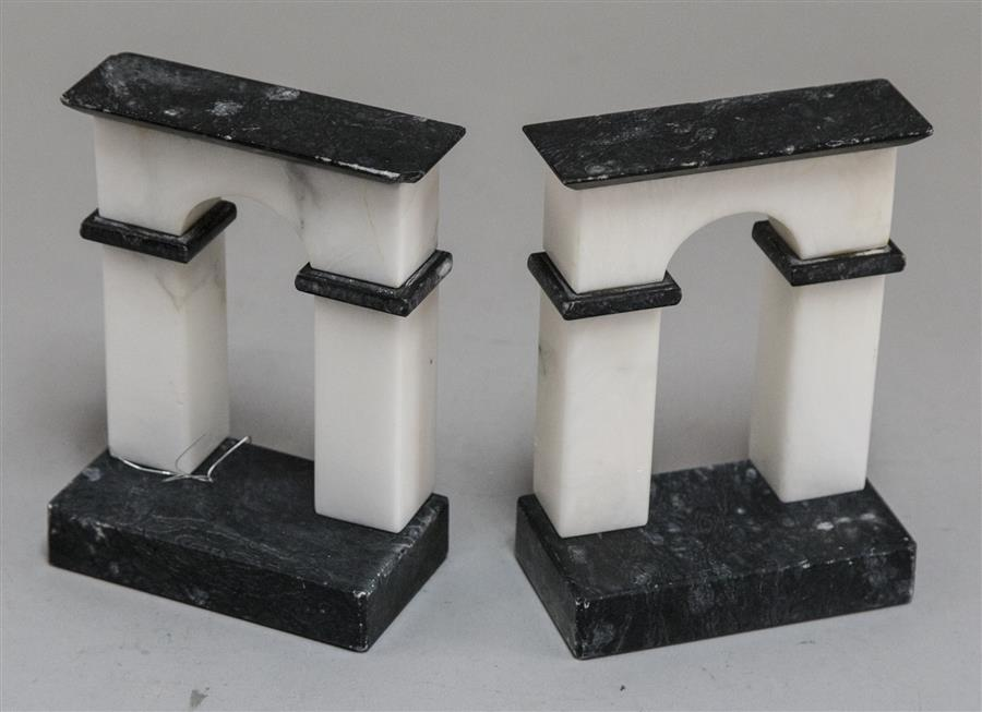 Pair of alabaster and marble bookends in the form of an arch