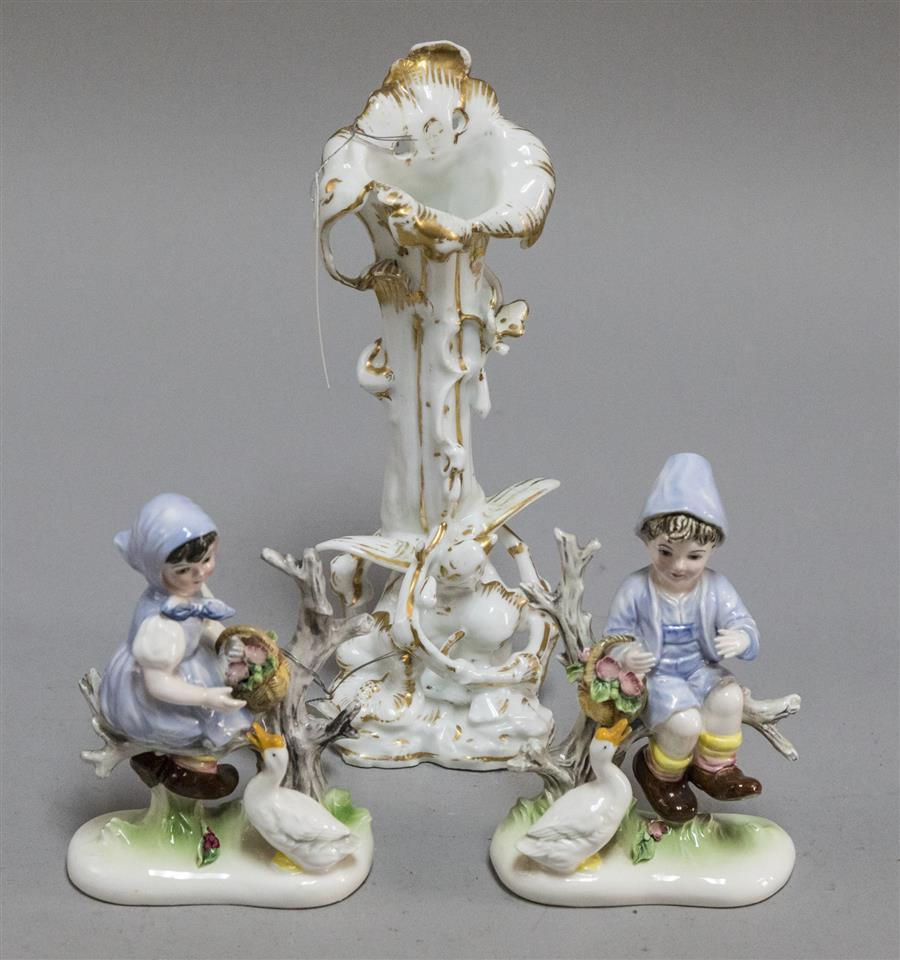 Old Paris vase with gilt accents and featuring a bird, and a pair of figurines of a young girl and young boy with geese