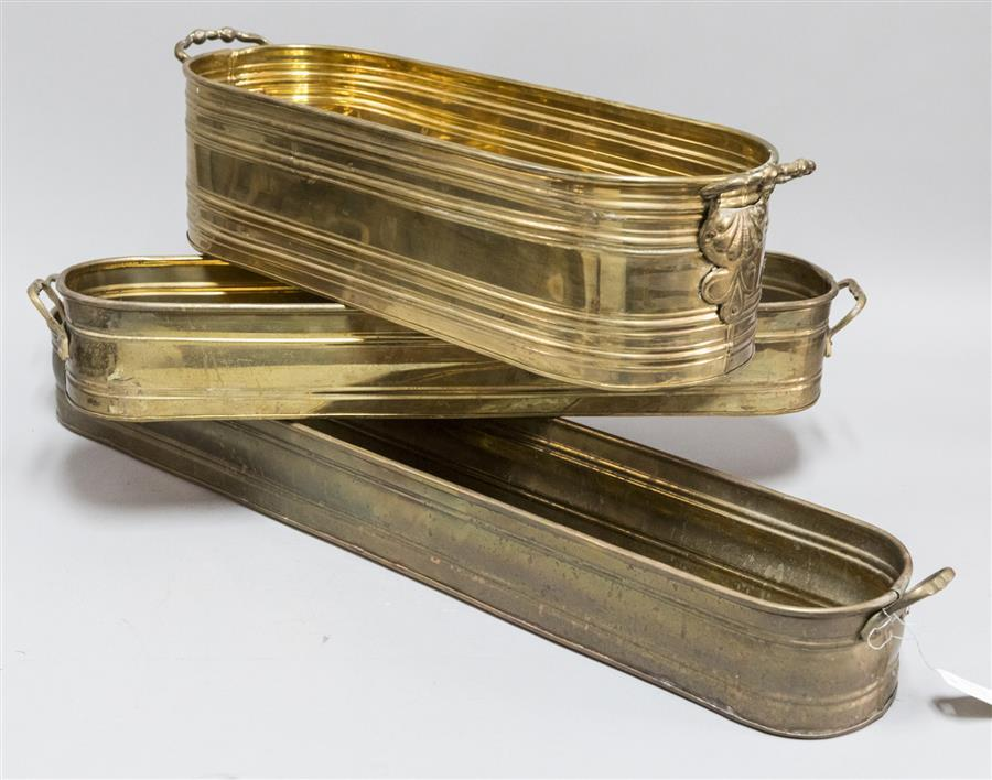 Three rectangular brass planters (lengths: 35 inches, 22 1/2 inches, and 26 inches)