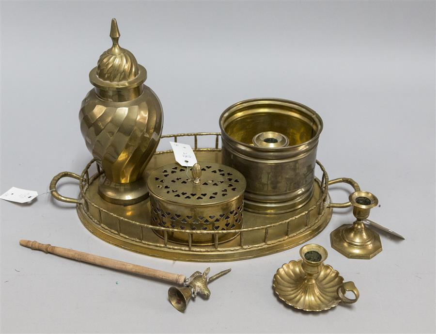 Collection of eight brass items including candlesticks, a candle snuffer, tray, lidded box, and other items