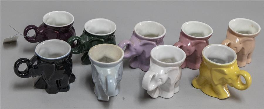 Nine Frankoma coffee mugs in the form of elephants and in a variety of colors (some dated and some stamped GOP)