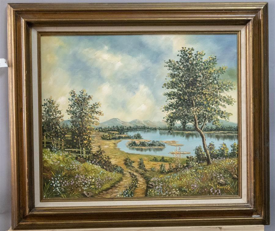 Framed oil on canvas depicting a landscape scene with a lake, artist signed Harris