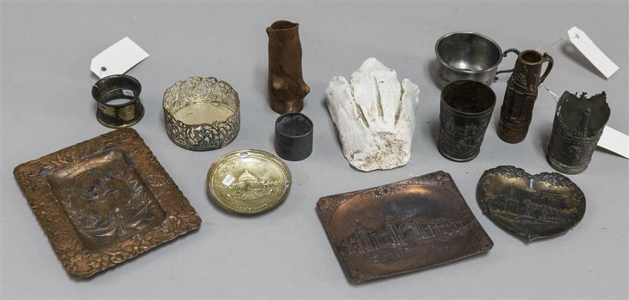 Collection of small metal World's Fair trays, napkin holders, vases, small cup from the World's Fair, and other items