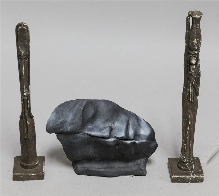 Two carved stone figures by K Silva and a ceramic sculpture by Sean Corner dated 2001