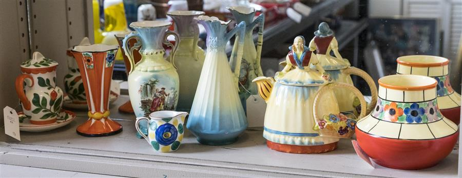 Seven hand painted porcelain items stamped Czechoslovakia including a tea pot, vases, a small pitcher, with underplate, and more