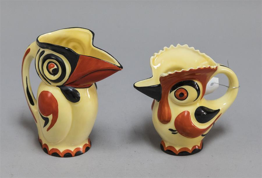 Two cockatoo bird pitchers, both hand painted and Made in Czechoslovakia; together with four books relating to Czechoslovakian glass
