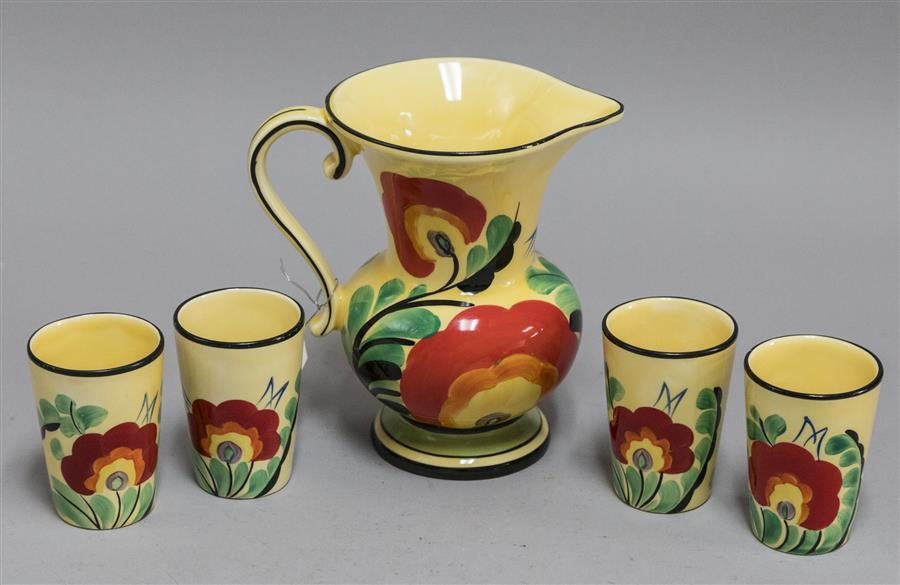 Tall hand painted pitcher and four matching glasses with artist mark and made in Czechoslovakia